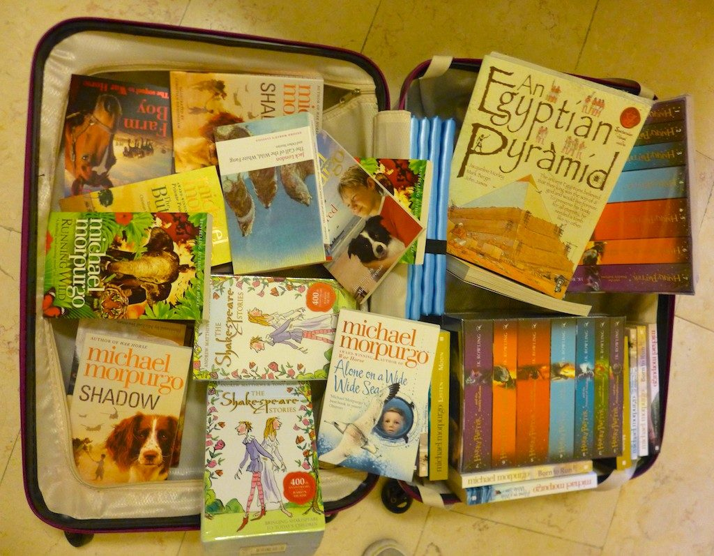 Suitcase of English books in trasit to Burin